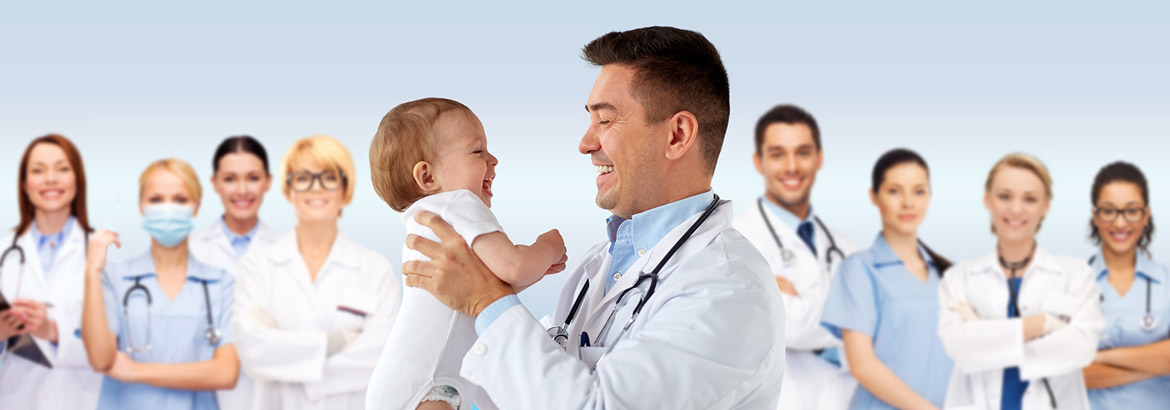 physician holding happy baby in front of colleagues